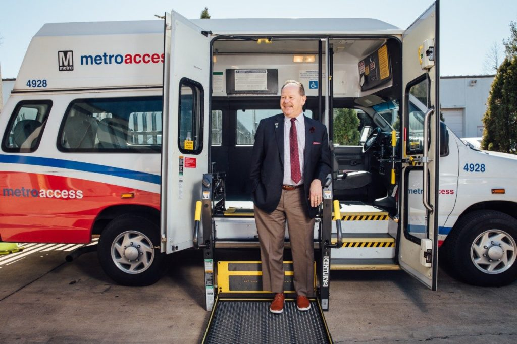 Robbie WErth Standing with MetroAccess vehicle.
