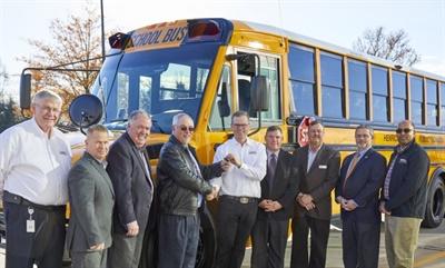Caley Edglery hands keys over to Henrico School's new DD5 school bus.